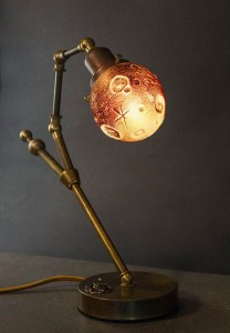 "Ross Delano ""Luna de sangre"" 11"" tall 13"" wide 5"" depth aged brass and sculpted glass lamp $890. (shown lighted)"