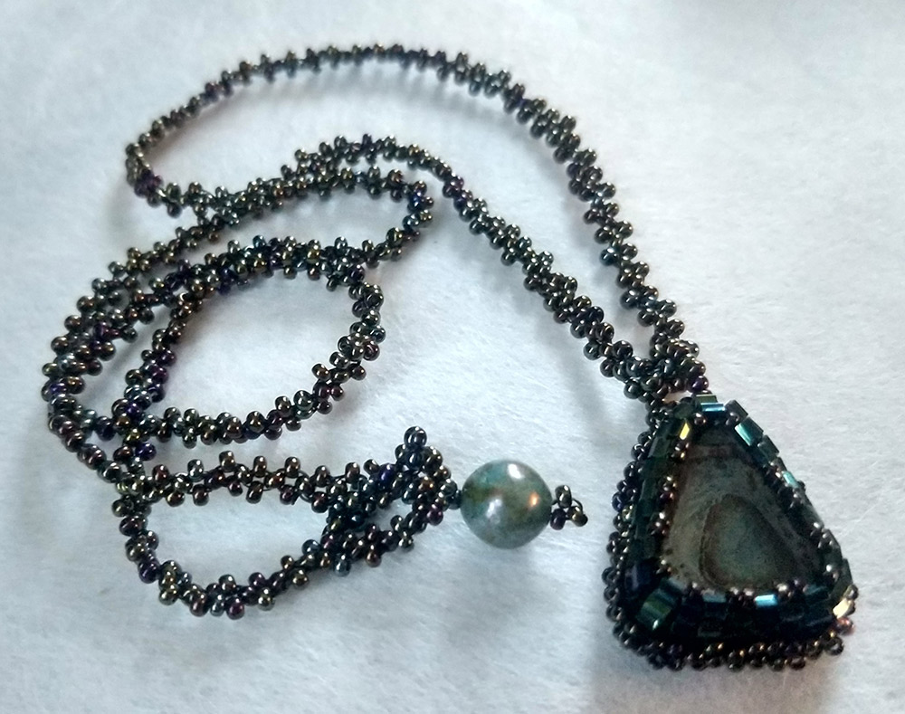 """Ann Recotta """"Bronze/Green Triangle Necklace"""" 18"""" chain with bead embroidery and bead weaving $115. SOLD"""
