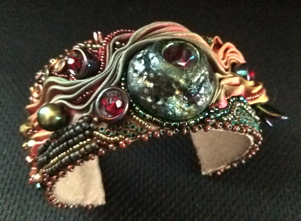 """Ann Recotta """"Eruption"""" (View A) 1.5"""" wide cuff with bead embroidery and bead weaving $200."""