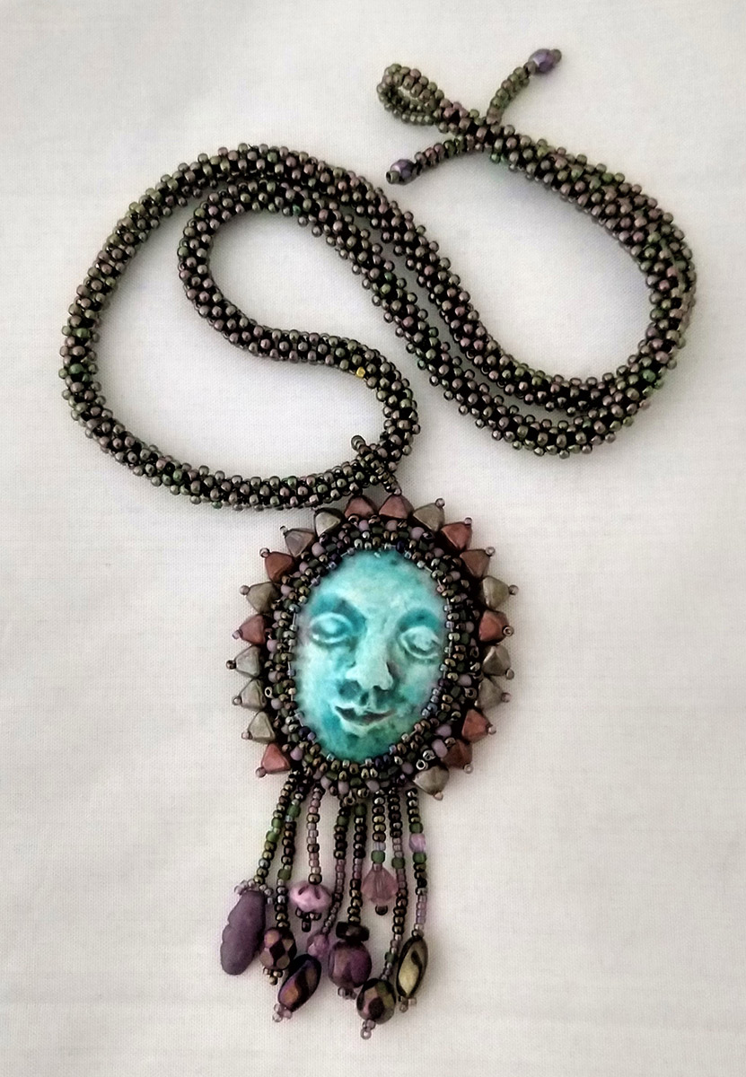 """Ann Recotta """"Somewhere Else Necklace""""18"""" chain with bead embroidery and bead weaving $150."""