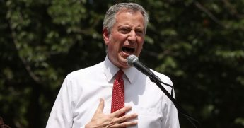 New York Mayor Bill de Blasio raises his voice Thursday to address thousands gathered in Brooklyn's Cadman Plaza Park for a memorial service for George Floyd, the man killed in police custody in Minnesota on May 25.