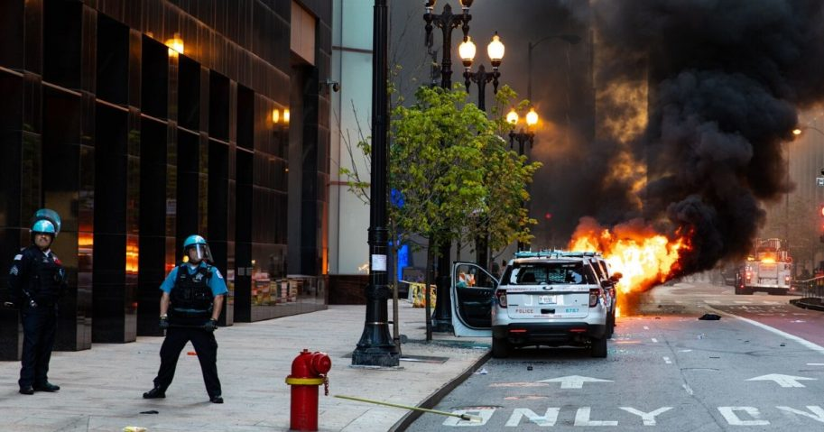 A vehicle set on fire explodes during riots on May 30, 2020, in Chicago.