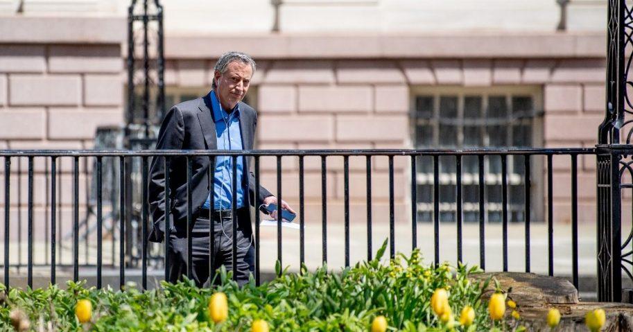 New York City Mayor Bill de Blasio walks outside City Hall on April 19, 2020, in New York City.