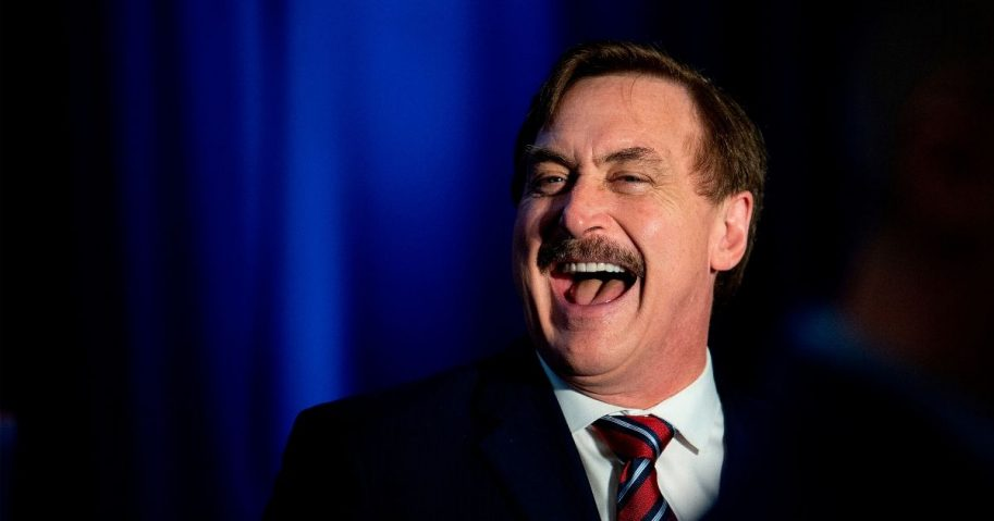 """MyPillow CEO Michael Lindell laughs during a """"Keep Iowa Great"""" news conference in Des Moines, Iowa, on Feb. 3, 2020."""