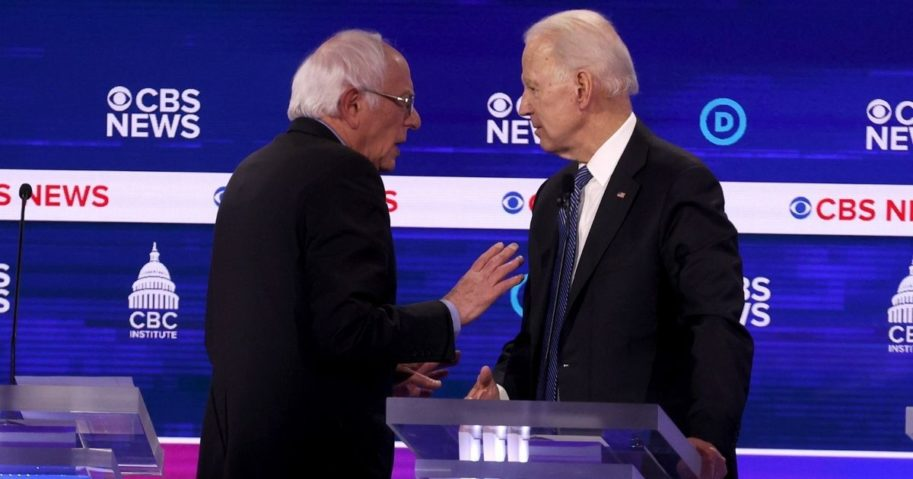 Progressive Sen. Bernie Sanders, left, and former Vice President Joe Biden speak during a break at the Democratic presidential primary debate at the Charleston Gaillard Center on Feb. 25, 2020, in Charleston, South Carolina.