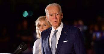 Former Vice President Joe Biden addresses the media and a small group of supporters with his wife, Jill Biden, during a primary night event on March 10, 2020, in Philadelphia.