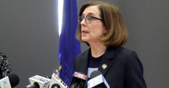 In this March 16, 2020, file photo, Oregon Gov. Kate Brown speaks at a news conference in Portland, Oregon.