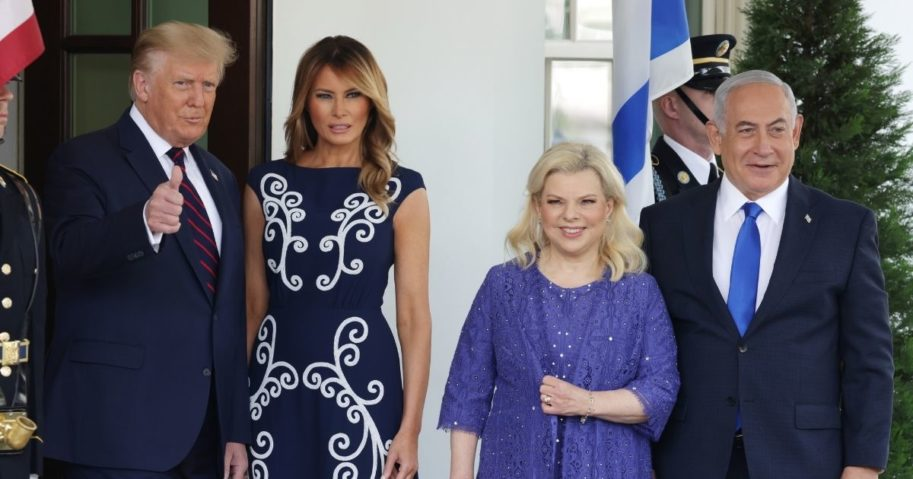 President Donald Trump, accompanied by first lady Melania Trump, gives a thumb's up to cameras on Tuesday before a historic signing ceremony between Israel, Bahrain and the United Arab Emirates at the White House. With the Trumps are Israeli Prime Minister Benjamin Netanyahu and his wife, Sara.