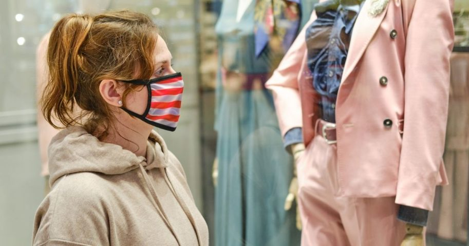 A woman wears a cloth mask in the stock image above.