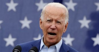 Democratic presidential nominee Joe Biden delivers remarks in the parking lot outside the United Auto Workers Region 1 offices on Sept. 9, 2020, in Warren, Michigan.
