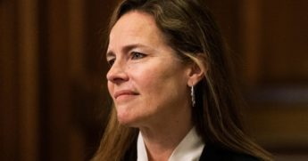 Supreme Court nominee Judge Amy Coney Barrett listens during a meeting with Republican Sen. Steve Daines of Montana on Capitol Hill in Washington on Oct. 1, 2020.