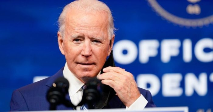 Joe Biden removes his face mask as he arrives to speak during an event to announce his choice of retired Army Gen. Lloyd Austin to be secretary of defense at The Queen theater in Wilmington, Delaware, on Wednesday.