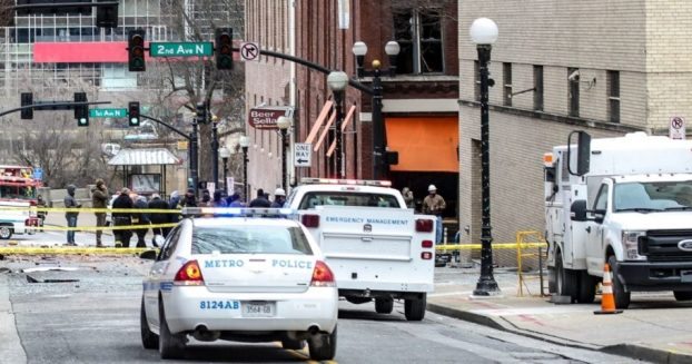 Nashville police and FBI agents work at the scene of the Christmas Day explosion in downtown Nashville.