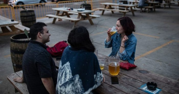 Patrons at a restaurant in Austin, Texas, go without masks after Texas ended its mask mandate earlier this month.