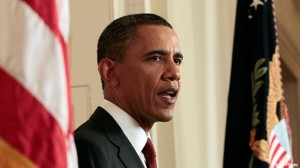Barack Obama between flags SC 300x168 U.S. government questioned Obamas citizenship when He was 5