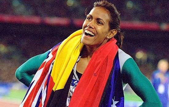 Cathy Freeman wearing the Australian and Indigenous flag
