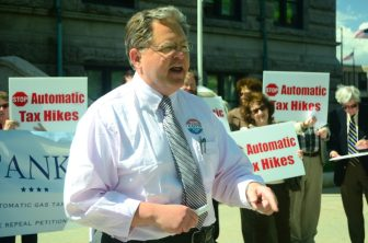 Dennis Galvin (R-Westford) speaks against the gas tax during an event in Lowell