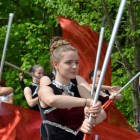 Westford Academy's Marching Band is preceded by their color guard.