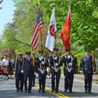 The Westford Firefighter Dept. Honor Guard followed by the Pipe and Drums.