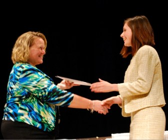 Nashoba Tech 2014 graduate Cara Masson of Westford receives the Westford Against Substance Abuse Scholarship from Principal Denise Pigeon at Nashoba Tech's recent Senior Awards Night). (courtesy: Dan Phelps)
