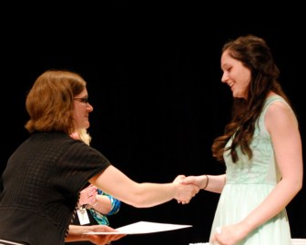 Nashoba Tech 2014 graduate Victoria Ronayne of  Westford receives the Academic Award for Social Studies from Principal Denise Pigeon at Nashoba Tech's recent Senior Awards Night. (courtesy: Dan Phelps)
