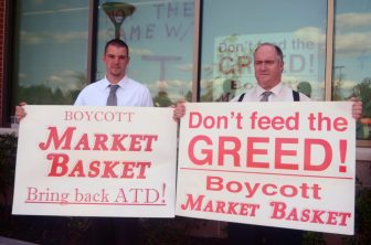 Patrick Martin (left) and Ken Murray at the Cornerstone Market Basket on Aug. 18, 2014