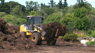 The compost being moved on Wednesday, Sept. 3, 2014 (credit: George Cox)