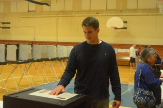 John Mangiaratti votes at the Abbot School on Sept. 9, 2014