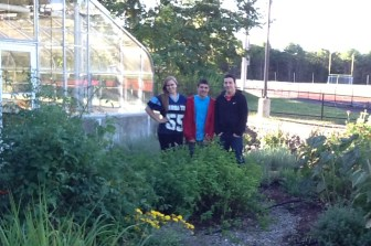Members of the Nashoba Tech Horticulture Club — from left, juniors Shelby Dudley (Townsend), Sean Defreitas (Pepperell) and Travis Conley (Lowell) — with the herb garden they recently expanded at the entrance to the school's restaurant. (courtesy Dan Phelps)