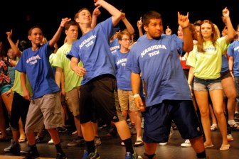 As part of Freshman Orientation at Nashoba Tech, freshmen had to work with Kick-Off Mentors to perform a dance routine in the Performing Arts Center, and these freshmen really got into it, showing their moves. From left are Joseph Schena of Chelmsford, Henry St. Amand of Chelmsford and Elio Sgrosso of Pepperell.