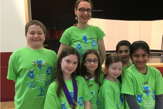 Pictured from the DI Otters team are (from left) 3rd grader Theo Baern of Westford, 3rd grader Dylan Kaplan of Littleton, 3rd grader Amalia Nagale of Bolton, 2nd grader Claire Westlund of Groton, 3rd grader Shane Trabulsi of Harvard, 3rd grader Prisha Dedhia of Acton, and (in the back row) team manager Sandra Nagale. Not pictured is team manager Audra Kaplan. (courtesy - Debbie Lusiter)