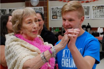 "Bridges resident Anne Lawson takes the lead while dancing with Nicholas Anderson, a junior from Chelmsford, during the ""Senior Prom"" that Nashoba Tech's Health Assisting program held for residents of the assisted-living facility. (Courtesy - Dan Phelps)"