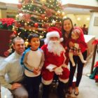 Santa poses with a local family at a previous Festival of Trees. COURTESY PHOTO