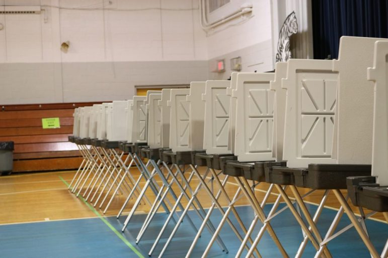 Rows of polling booths await voters on May 2.  PHOTO BY JOYCE PELLINO CRANE
