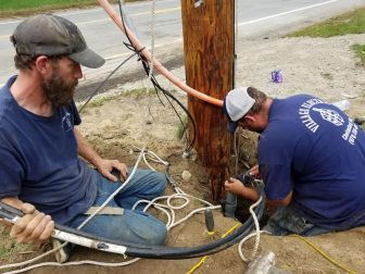 Electricians make reparations to the underground wires on Oct. 7. PHOTO BY JOYCE PELLINO CRANE