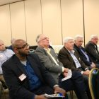A group of Westford Business Association members listen intently to a speaker. PHOTO BY JOYCE PELLINO CRANE