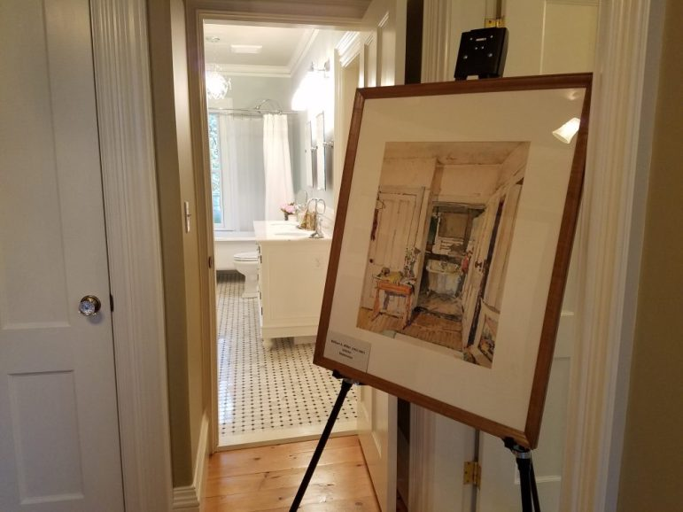 bathroom with painting