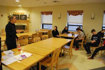 Jenifer Apazidis, owner of The Red Raven restaurant in Acton and founder of the Purple Table Reservation program, talks to students at Nashoba Tech's restaurant, The Elegant Chef, about the program. The Elegant Chef is the first school restaurant to commit to joining the program. COURTESY PHOTO