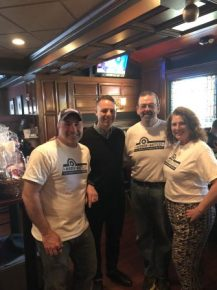 Hidden Battles founder Scott Hyder with state Rep. James Arciero, retired Westford police officer Michael Croteau and Michelle Hyder. COURTESY PHOTO
