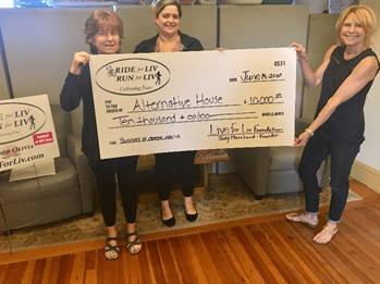 Kathy Kelley and Maria Crooker of Alternative House are presented with a donation from the Live for Liv Foundation, presented by founder, Jody Marchand. COURTESY PHOTO