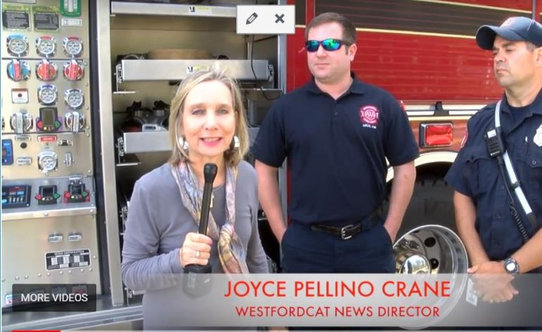 WestfordCAT News Director Joyce Pellino Crane with Firefighters Justin Searles and Brian Baker. WESTFORDCAT PHOTO