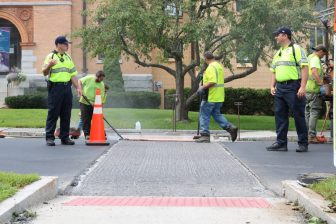 Workers install a faux brick crosswalk in front of the J.V. Fletcher Library in Westford on Aug. 21. PHOTO BY JOYCE PELLINO CRANE