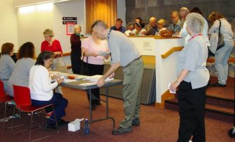 Westford residents line up for registration in a seasonal flu clinic at the Fletcher Library. PHOTO BY NANCY BURNS