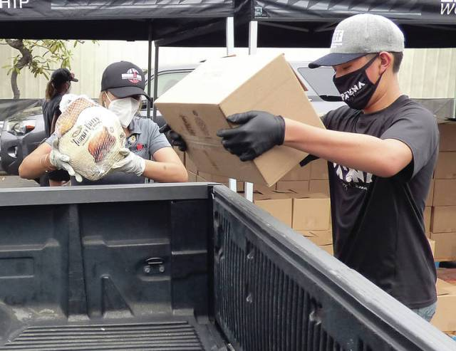 The spirit of giving: Ironman Foundation provides Thanksgiving bundles to 600 families