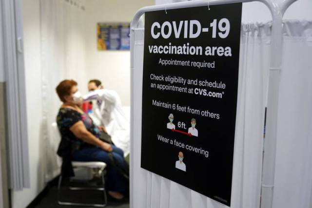 Americans vaccinated against COVID-19 still wait for advice