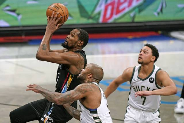 NBA playoff capsules: Nets rout Bucks and Suns beat Nuggets
