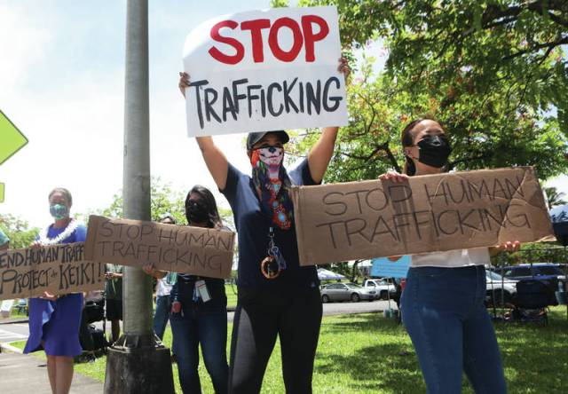 Dozens turn out to sign wave during World Day Against Trafficking in Persons