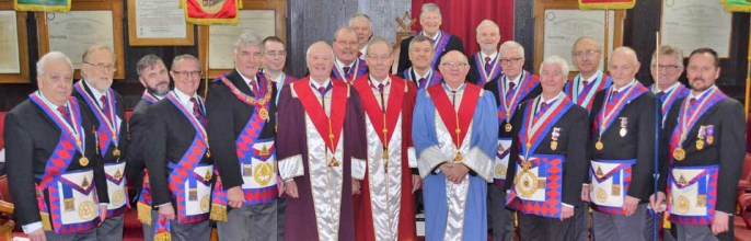 Pictured centre left is Paul Renton, the three principals (centre), Jim Wilson (centre right), Neil MacSymons (far right) and members of the Provincial Grand Stewards; Chapter team.