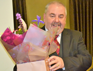 Chris with a bouquet of flowers for his wife, from the companions of the chapter.