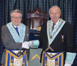 Bill McGhee (left) congratulating Mel Cross